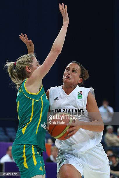 Jillian Harmon of New Zealand drives into Australia Carly Wilson of during the second match between the Australian Opals and the New Zealand Tall...