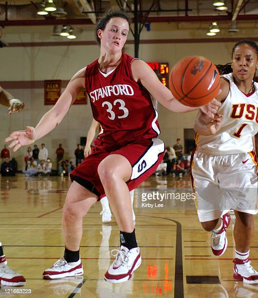 Jillian Harmon of Stanford and Camille LeNoir of USC battle for loose ball in Pacific10 Conference women's basketball game at the Lyon Center in Los...