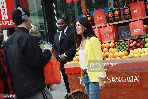 Jillian Harris hands out bags at Madria Sangria booth at Union Square on May 3 2012 in New York City