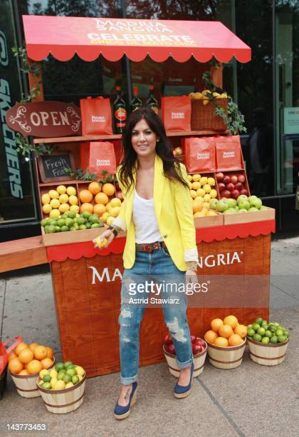 Jillian Harris poses for photos at the Madria Sangria booth at Union Square on May 3, 2012 in New York City.