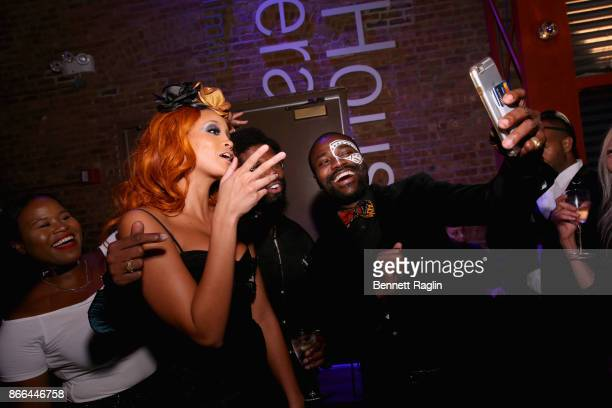 Jillian Hervey of Lion Babe and Abiola Oke take a selfie during the MoCADA 3rd Annual Masquerade Ball at Brooklyn Academy of Music on October 25 2017...