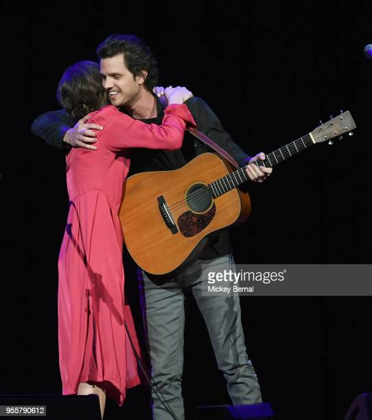 Jillian Jacqueline and Steve Moakler hug onstage during the 3rd Annual AIMP Awards at Ryman Auditorium on May 7 2018 in Nashville Tennessee