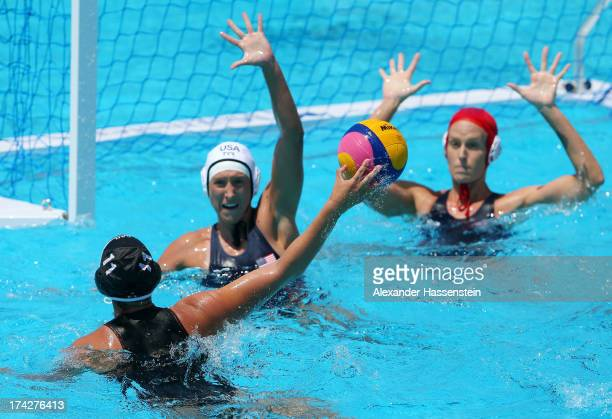 Jillian Kraus and goalkeeper Tumuaialii Anae of USA try to block Stephanie Valin of Canada's shot at goal during the Women's Water Polo first...