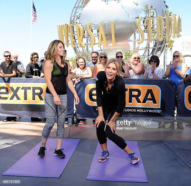"""Jillian Michaels and Charissa Thompson workout together at """"Extra"""" at Universal Studios Hollywood on September 9, 2014 in Universal City, California."""