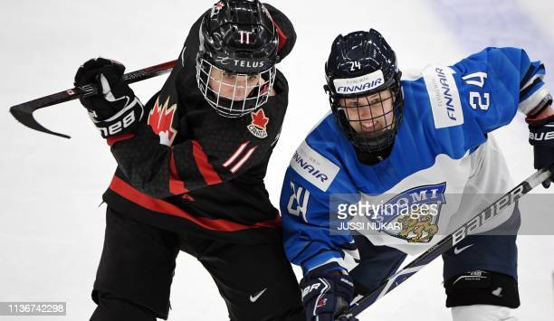 Jillian Saulnier of Canada and Noora Tulus of Finland vie during the IIHF Women's Ice Hockey World Championships semifinal match between Canada and...