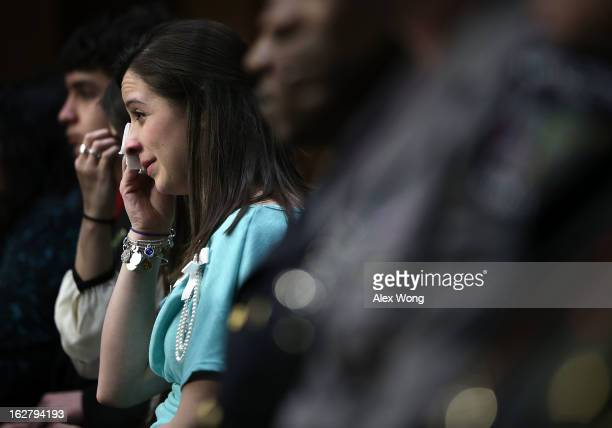 Jillian Soto sister of Sandy Hook Elementary shooting victim firstgrade teacher Victoria Soto wipes tears during a hearing before the Senate...