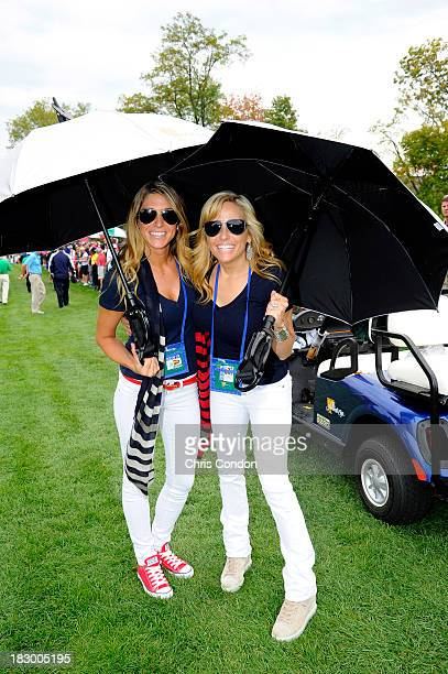 Jillian Stacey and Amy Mickelson follow the play of the US Team during the Day One FourBall Matches of The Presidents Cup at the Muirfield Village...