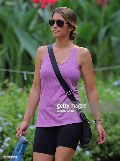 Jillian Stacey girlfriend of Keegan Bradley of USA walks to the 9th hole during round two of the CIMB Classic at Kuala Lumpur Golf Country Club on...