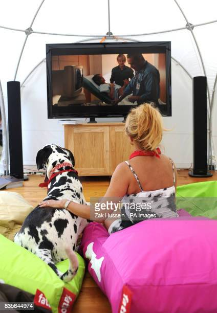 Jilly Johnson and her dog Boris watch the film Marley and Me during the Macmillan Dog Day 2009 at the Royal Chelsea Hospital in south west London