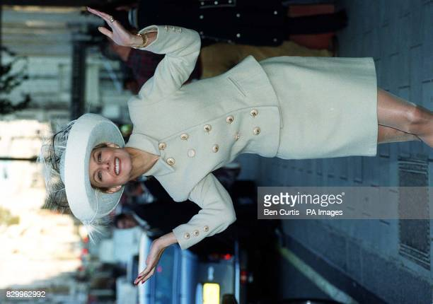 Jilly Johnson model and author dons a Herbert Johnson hat as she arrives for the charity 'Mad Hatter's Tea Party' at Claridges London a fundraising...