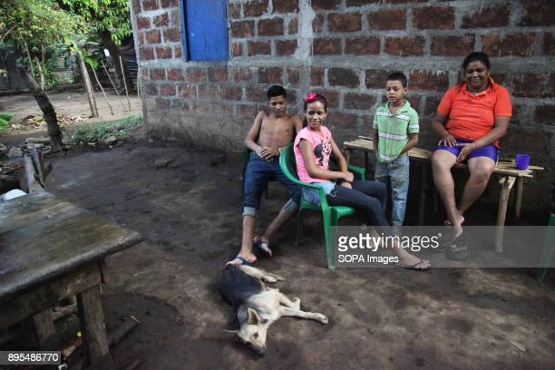 CHICHIGALPA CHINANDEGA NICARAGUA Jilma Urbina aged thirtyeight and her three children at their house in Chichigalpa Jilma has lost her father husband...