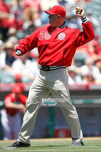Jim Abbott former pitcher for the Los Angeles Angels of Anaheim throws out the celebratory first pitch during the game between the Los Angeles Angels...