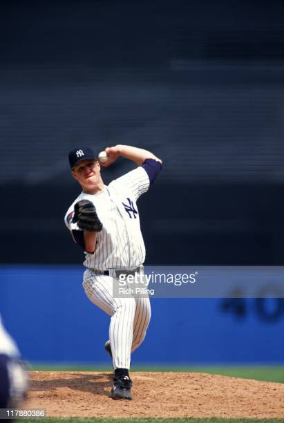 Jim Abbott of the New York Yankees delivers a pitch during a game against the Kansas City Royals at Yankee Stadium on June 5 1994 in the Bronx New...