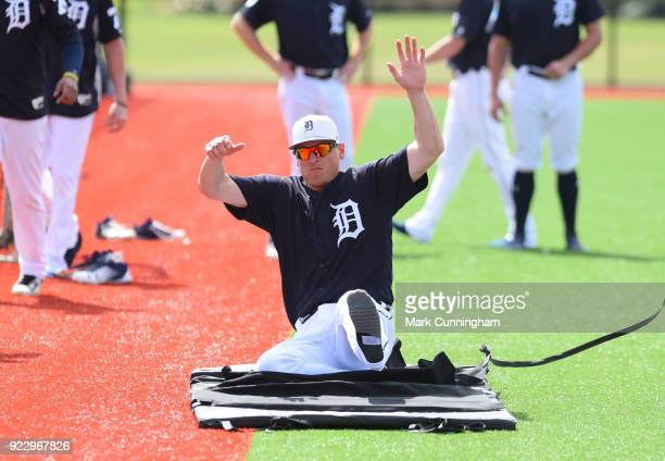 Jim Adduci of the Detroit Tigers works on a sliding drill during Spring Training workouts at the TigerTown Facility on February 21 2018 in Lakeland...