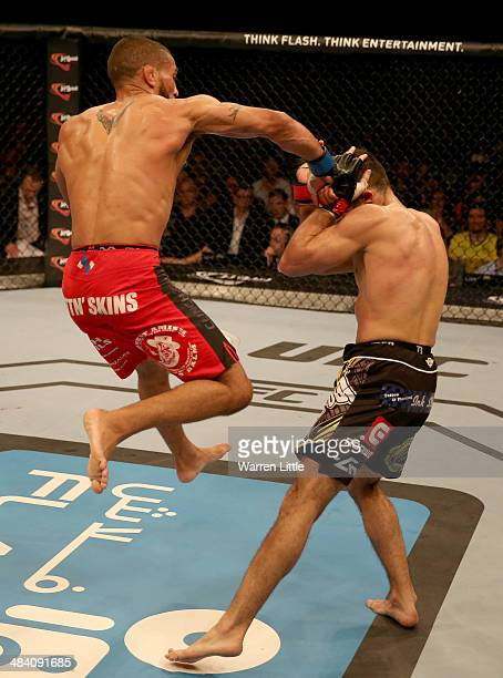 Jim Alers jumps and throws a right at the head of Alan Omer during their bout during UFC Fight Night 39 at du Arena on April 11, 2014 in Abu Dhabi,...