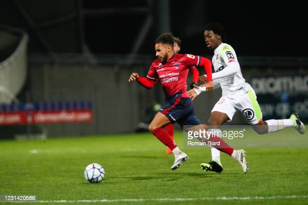 Jim ALLEVINAH of Clermont and Ismael DOUKOURE of Valenciennes during the Ligue 2 BKT match between Clermont and Valenciennes on February 27, 2021 in...