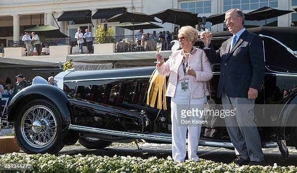 Jim and Dot Patterson lift a glass in celebration of their Best of Show win at the 65th Annual Pebble Beach Concours d'Elegance awarded them for...