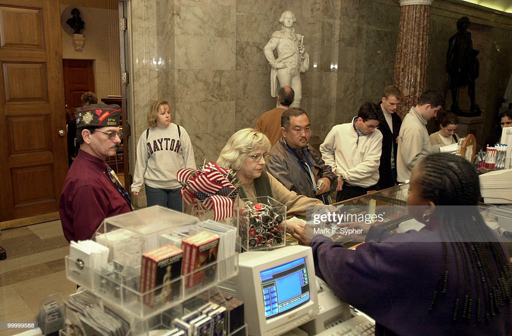 Jim (left) and Kathy Mann (at register) make their visit to the U.S. Capitol from Oklahoma City a memorable one, by purchasing trinkets at the gift shop from Zabrina Smith, who has worked there for two years.