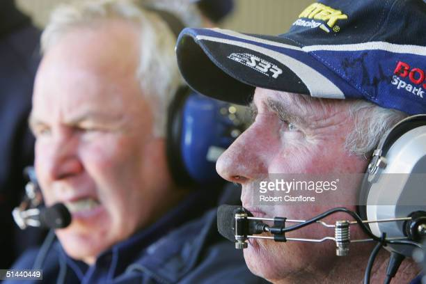 Jim and Ross Stone of the Stone Brothers Racing Team watch the timing screen during qualifying for the Bathurst 1000 which is round ten of the 2004...
