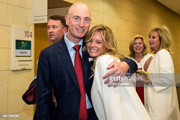 Jim and Tabitha Furyk of Team USA pose following The Presidents Cup Opening Ceremony at Songdo Convensia on October 7 2015 in Songdo IBD Incheon City...