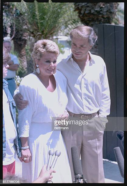 Jim and Tammy Bakker talk to reporters outside their Palm Springs mansion