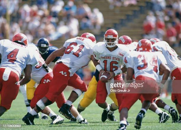 Jim Arellanes, Quarterback for the Fresno State Bulldogs prepares to hand off the ball to Running back Michael Pittman during the NCAA Pac-10...