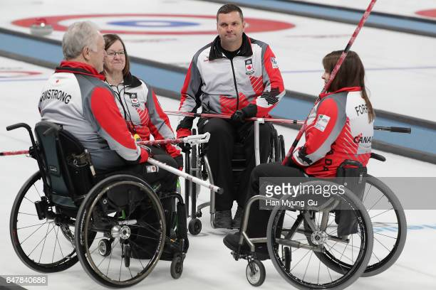 Jim Armstrong Mark Ideson Ina Forrest and Marie Wright from Canada deliver a stone during the World Wheelchair Curling Championship 2017 test event...