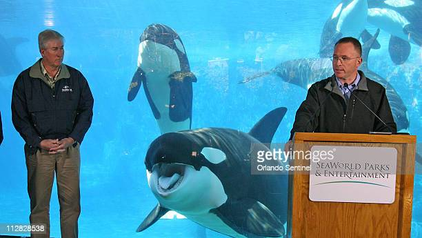 Jim Atchison, president and CEO SeaWorld Parks & Entertainment, speaks during a news conference Friday, February 26 with killer whales behind...