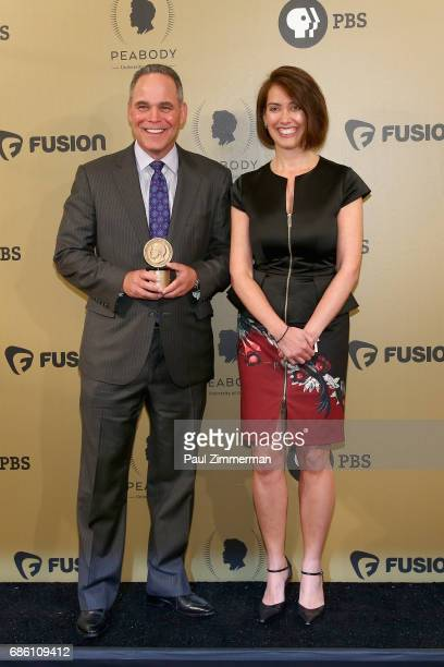 Jim Axelrod and Ashley Velie pose with an award during The 76th Annual Peabody Awards Ceremony at Cipriani Wall Street on May 20 2017 in New York City