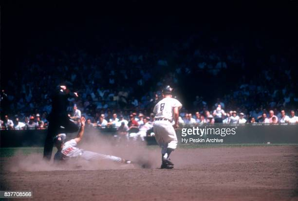 Jim Baxes of the Cleveland Indians is called out at second base as Rocky Bridges of the Detroit Tigers beat Baxes to the bag during an MLB game on...