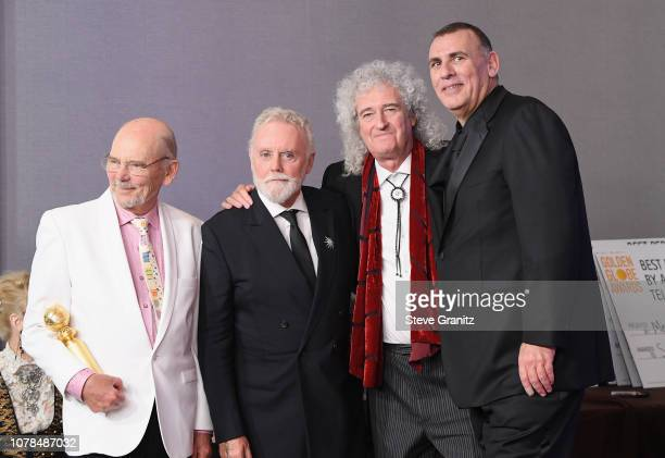 Jim Beach Roger Taylor and Brian May of Queen and Graham King pose in the press room during the 76th Annual Golden Globe Awards at The Beverly Hilton...