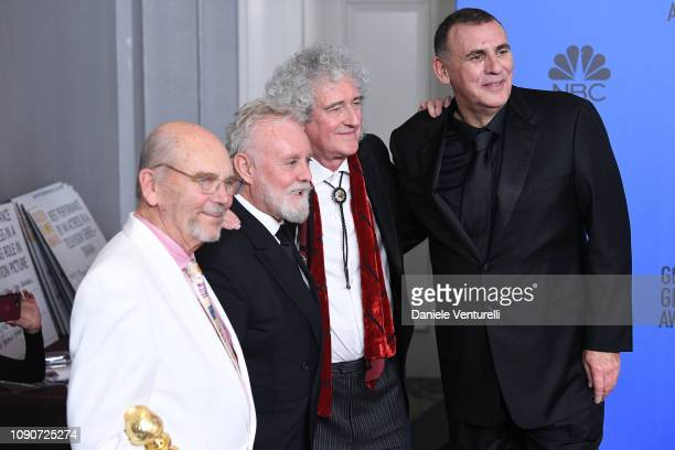 Jim Beach Roger Taylor and Brian May of Queen and Graham King poses in the press room during the 75th Annual Golden Globe Awards at The Beverly...