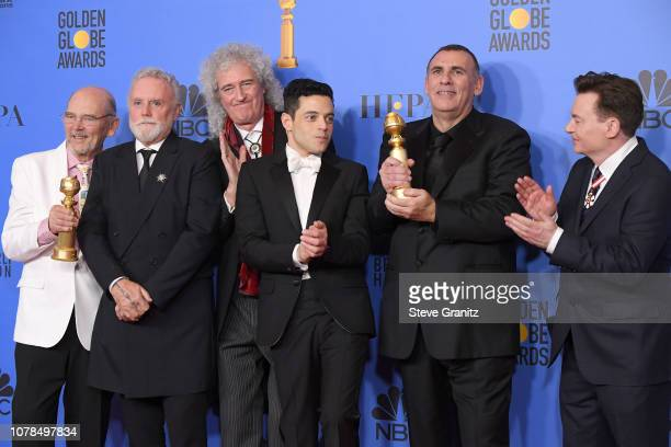 Jim Beach Roger Taylor and Brian May of Queen Rami Malek Graham King and Mike Myers pose in the press room during the 76th Annual Golden Globe Awards...