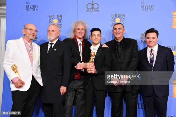 Jim Beach Roger Taylor and Brian May of Queen Rami Malek Graham King and Mike Myers pose in the press room during the 75th Annual Golden Globe Awards...