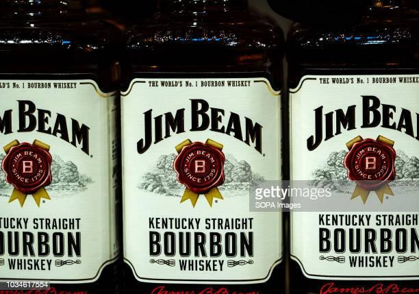Jim Beam Kentucky Borubon Whiskey seen on store shelf. Jim Beam is a brand of bourbon whiskey, a subsidiary of Suntory Holdings of Osaka, Japan.
