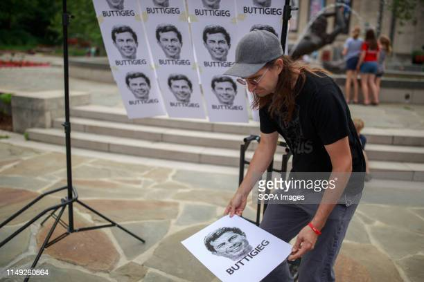 Jim Beck of badkneests screen prints posters of South Bend Mayor Pete Buttigieg who is running for the Democratic nomination for president of the...