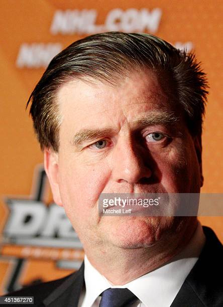 Jim Benning General Manager of the Vancouver Canucks is interviewed during a press conference after the first round of the 2014 NHL Draft at the...