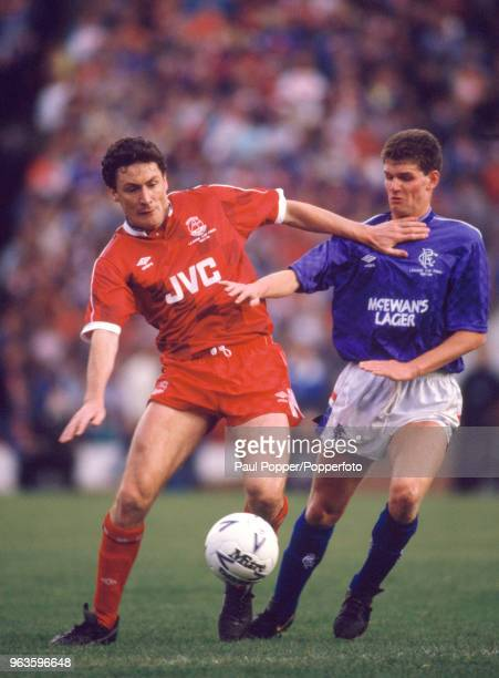 Jim Bett of Aberdeen holds off Ian Durrant of Rangers during the Skol Cup Final at Hampden Park on October 25 1987 in Glasgow Scotland