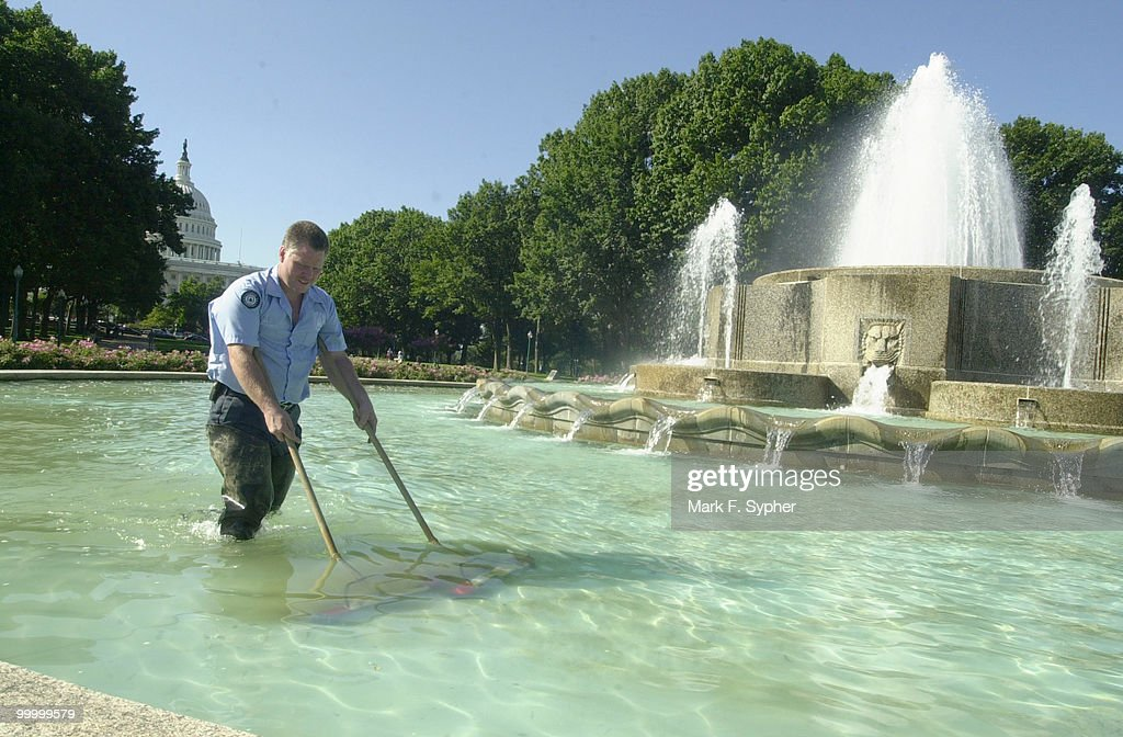 Jim Bird, a Capital Hill worker for 19 years, cleans the North Fountain next to the Russell Senate Office Bulding on a picture perfect Wednesday morning.