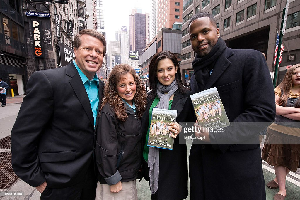 Jim Bob Duggar, wife Michelle Duggar, Hilaria Baldwin, and AJ Calloway visit 'Extra' in Times Square on March 11, 2013 in New York City.