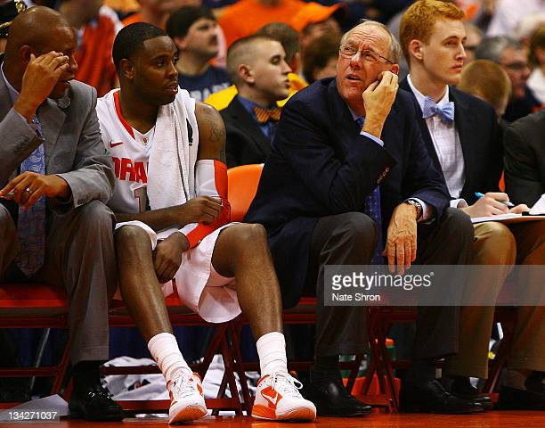 Jim Boeheim head coach of the Syracuse Orange looks up to the scoreboard while sitting on the bench during the game against the Eastern Michigan...