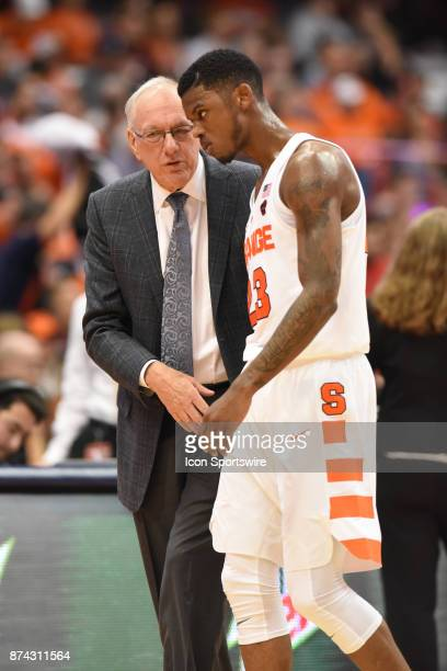 Jim Boeheim #Head coach of the Syracuse Orange talks to Frank Howard of the Syracuse Orange during the second half of play between the Syracuse...