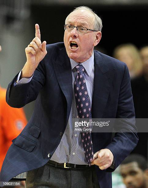 Jim Boeheim the Head Coach of the Syracuse Orange gives instructions to his team during the Big East Conference game against the Louisville Cardinals...