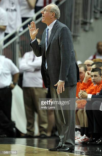 Jim Boeheim the head coach of the Syracuse Orange gives instructions during the Big East Conference game against the Louisville Cardinals at KFC YUM...