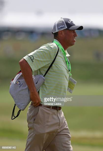 Jim 'Bones' Mackay walks along the course during a practice round prior to the 2017 US Open at Erin Hills on June 13 2017 in Hartford Wisconsin