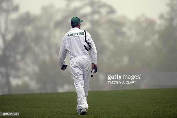 Jim 'Bones' Mackaycaddy for Phil Mickelson of the US walks the course to get yardages April 7 2014 at Augusta National Golf Club in Augusta Georgia...