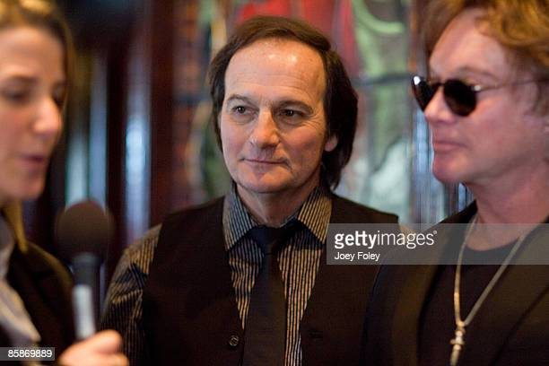 Jim Bonfanti and Eric Carmen of The Raspberries attend a memorabilia donation at the Hard Rock Cafe on April 4 2009 in Cleveland Ohio