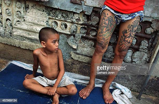 Jim Boy a six year old child who lives with his father in a cell in the block for Batang City gang one of four gangs at Manila City Jail Manila City...