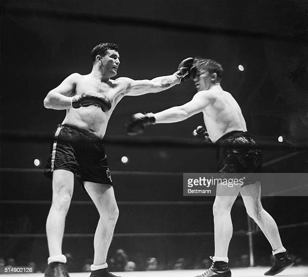 Jim Braddock flicks Tommy Farr with a right during their ten round bout at Madison Square Garden January 21 1938 Farr's right fell short On the...