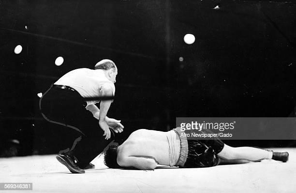 Jim Braddock in the ring losing heavyweight title to Joe Louis June 26 1937